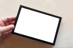 Leerer Fotorahmen auf weißem Hintergrund Stockfoto