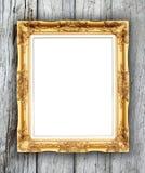 Leerer goldener Rahmen auf hölzerner Wand lizenzfreie stockfotos
