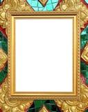 Leerer goldener Rahmen auf thailändischer Artbuddha-Wand lizenzfreie stockfotografie