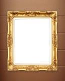 Leerer goldener Rahmen auf whtie Zementwand lizenzfreie stockbilder