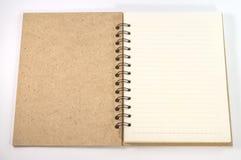 Leerer leerer Notizblock auf Weiß Stockbild