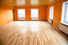 Leerer orange Raum Stockfotografie