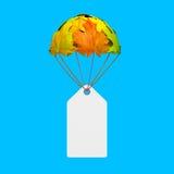 Leerer Papier-Preisaufkleber mit dem Fallschirm hergestellt von den Herbstahornblättern Stockfoto