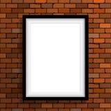 Leerer Rahmen auf brauner Backsteinmauer Lizenzfreies Stockbild