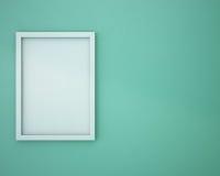 Leerer Rahmen auf grüner Wand Stockfotografie