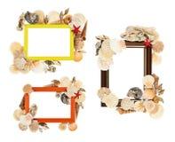 Leerer Rahmen verziert mit Muscheln Stockfotos