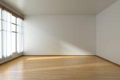 Leerer Raum mit Parkettboden und Fenster Stockbild