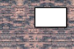 leerer schwarzer Bilderrahmen auf der alten Backsteinmauer mit Kopienraum Lizenzfreie Stockfotografie