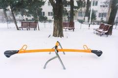 Leerer Spielplatz im Winter Lizenzfreie Stockfotografie