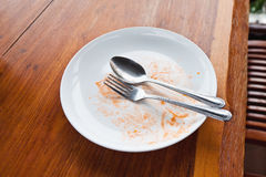Leerer Teller nach Nahrung Stockfotos