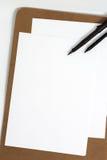 Leerer Weißbuchhintergrund Lizenzfreie Stockfotos