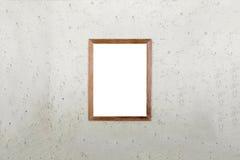 Leeres Holzrahmenbild auf Zementwandhintergrund Weißes Brett Stockfotografie