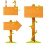 Leeres Holzschildbrett mit dekorativen Ranken Lizenzfreies Stockfoto
