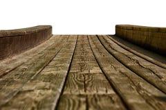 Leeres Holztischspitzen lokalisiert auf dem weißen Hintergrund, benutzt für Anzeige oder Montage Ihre Produkte stockfoto