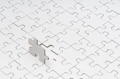 Leeres Puzzlespiel mit fehlendem Teil Stockfoto