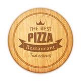 Leeres rundes Schneidebrett mit Pizzarestaurantaufkleber Lizenzfreies Stockbild