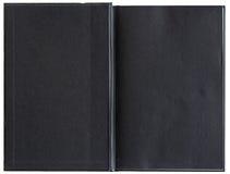 Leeres Schwarzbuch geöffnet zur ersten Seite Stockfotografie