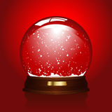 Leeres snowglobe auf Rot Stockfotos