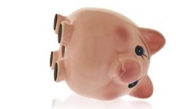 Leeres Sparschwein auf Seite Lizenzfreie Stockfotografie