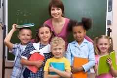 Leerlingen en leraar Stock Afbeeldingen