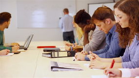 Leerlingen in school het leren Stock Afbeelding