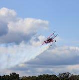 Leesburg Airshow Airborne Plane. Powered aircraft ascending in air in aerobatic performance of gravity-defying maneuvers at airshow in Leesburg, Virginia Stock Photo