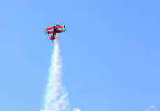 Leesburg Airshow Airborne Plane. Powered aircraft ascending in air in aerobatic performance of gravity-defying maneuvers at airshow in Leesburg, Virginia royalty free stock photos