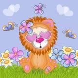 Leeuw met bloemen Stock Foto