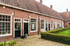 Leeuwarden, The Netherlands, april 14 2018, Authentic small cour. Tyard Jacobijnenhof where locals still live Stock Photography