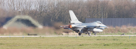 LEEUWARDEN, NETHERLANDS - APRIL 11, 2016: A dutch F-16 on the gr Stock Images