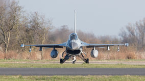 LEEUWARDEN, NETHERLANDS - APRIL 11, 2016: A dutch F-16 on the gr Royalty Free Stock Photography