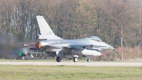 LEEUWARDEN, NETHERLANDS - APRIL 11, 2016: A dutch F-16 on the gr Stock Image