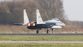 LEEUWARDEN, NETHERLANDS - APRIL 11, 2016: US Air Force F-15 Eagle takking off during the exercise Frisian Flag. The exercise is c royalty free stock photo