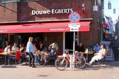 Leeuwarden, Netherlands, May 2018, People enjoy outdoor cafe terrace Douwe Egberts Stock Image