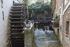 Water mill covered with snow in winter time royalty free stock images