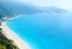 Lefkada coast beach (Greece). Beautiful summer Lefkada coast beach (Greece, Ionian Sea)  view from up (all peoples unrecognizable Stock Image