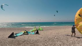 LEFKADA, GREECE, JUNE 27, 2017, AGIOS IOANNIS, Kitesurfers on the beautiful Agios Ioannis in Gira beach of Lefkada island, Greece stock video footage