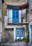 Old abandoned house with blue door and window in village Lefkara, Cyprus. LEFKARA, CYPRUS - JANUARY 9, 2018: Old abandoned house with blue door and window in royalty free stock image