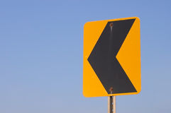 Left. Turn yellow reflective sign on a clear blue sky background Royalty Free Stock Photography