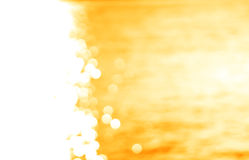 Left aligned glowing sun path yellow ocean with light leak backg Stock Photos