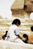 Left Alone. A boy left alone near Sphinx, Giza, Egypt Royalty Free Stock Images