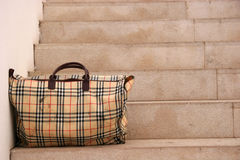 Left bag. Forgotten bag on a stairs Royalty Free Stock Images