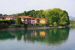 The left bank of Oglio river and a part of Paratico town, seen from the bridge who connect the cities Sarnico and Paratico. Lago d`Iseo or Sebino is the fourth royalty free stock images