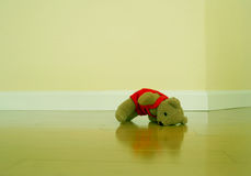 Left behind. Teddybear on a wooden floor Stock Photos