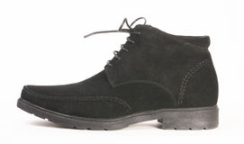 The left black suede boot Royalty Free Stock Images
