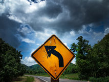 Left curve. Road sign in left curve Royalty Free Stock Image