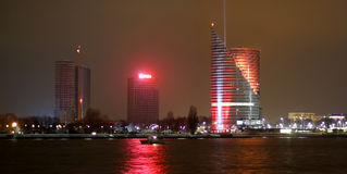 The left Daugava shore with Latvian flag in Riga center in night Royalty Free Stock Image