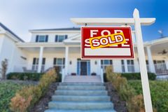 Left Facing Sold For Sale Real Estate Sign In Front of House. stock photos