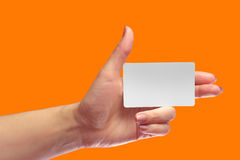 Left Female Hand Hold Blank White Card Mock-up. SIM Cellular Stock Photo