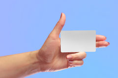 Left Female Hand Hold Blank White Card Mock-up. SIM Cellular Pla Royalty Free Stock Photography